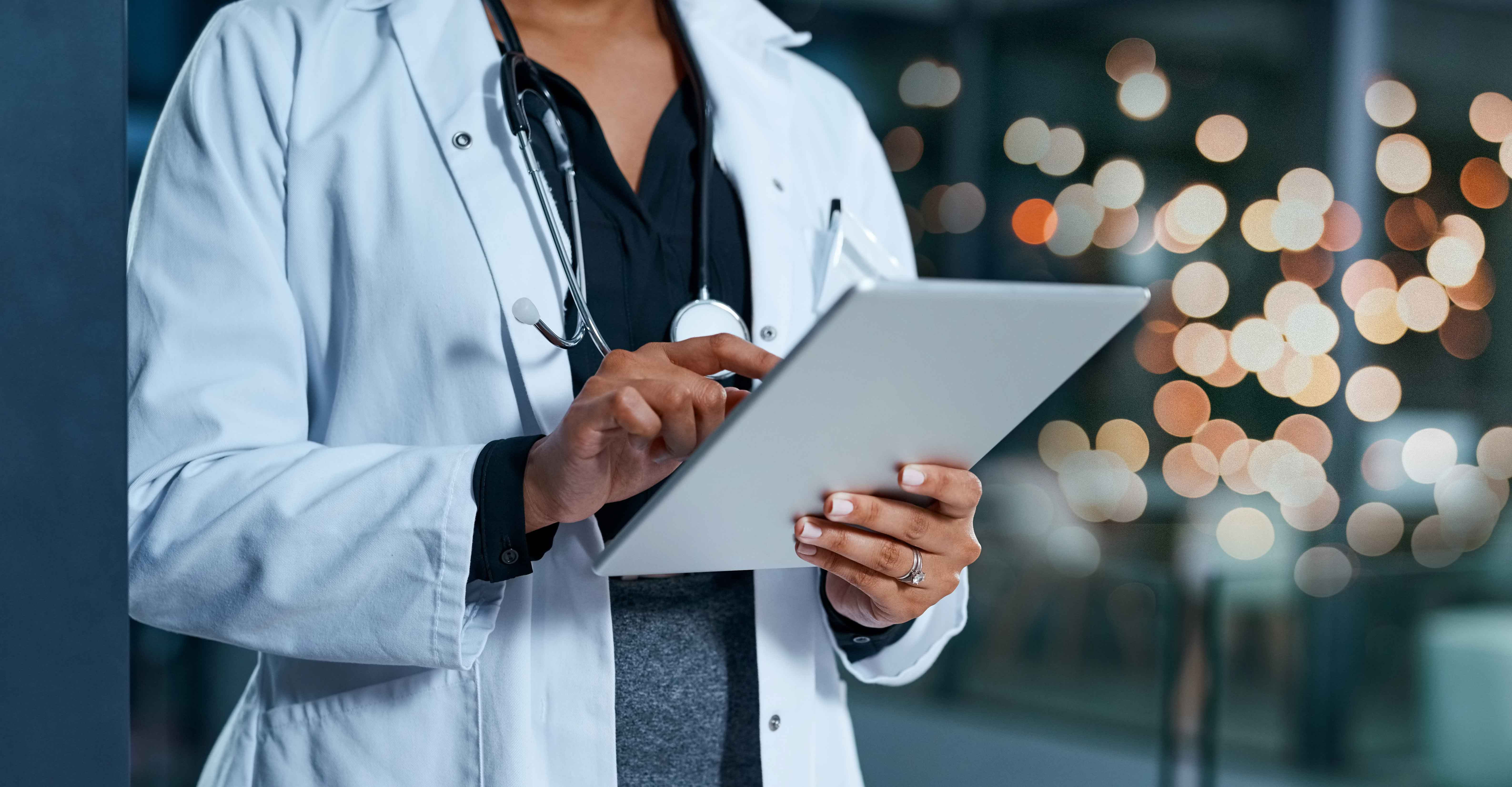 A doctor uses a wound care app on a tablet in the hospital