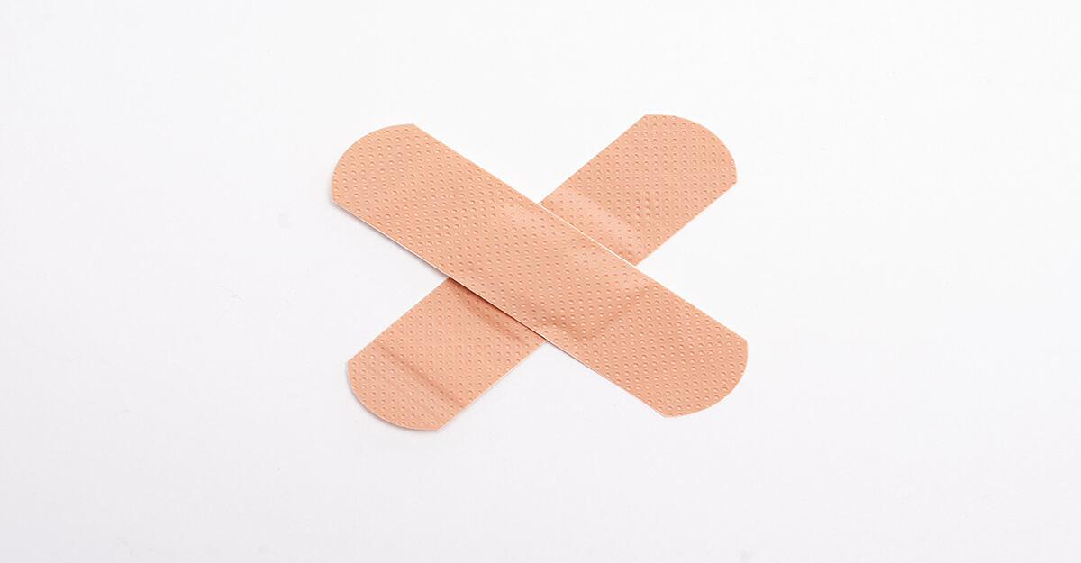 band aids forming an x